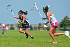 Sophomore Brooke Ottaway speeds past a defender in a tournament for the Detroit Coyotes.Photo credit: Liz Ottaway