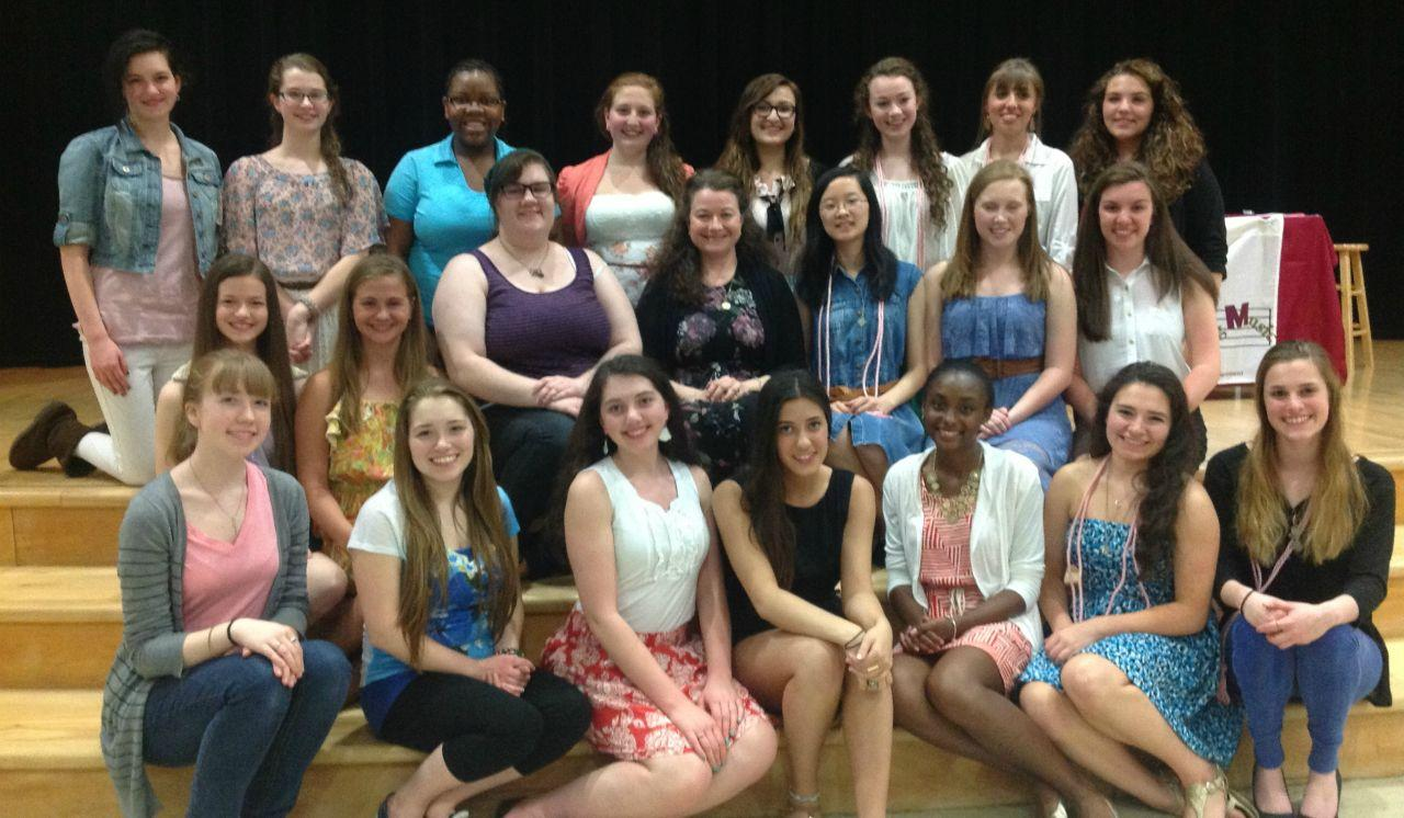 Mrs. Malaney, center, poses with the members of the Tri-M Music Honor Society, of which she is the moderator.  Photo reprinted with permission from Amy Malaney.