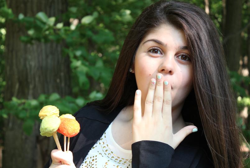 Junior Sanan Malkadjian advertises her cake pops.  Photo Credit: Sanan Malkadjian