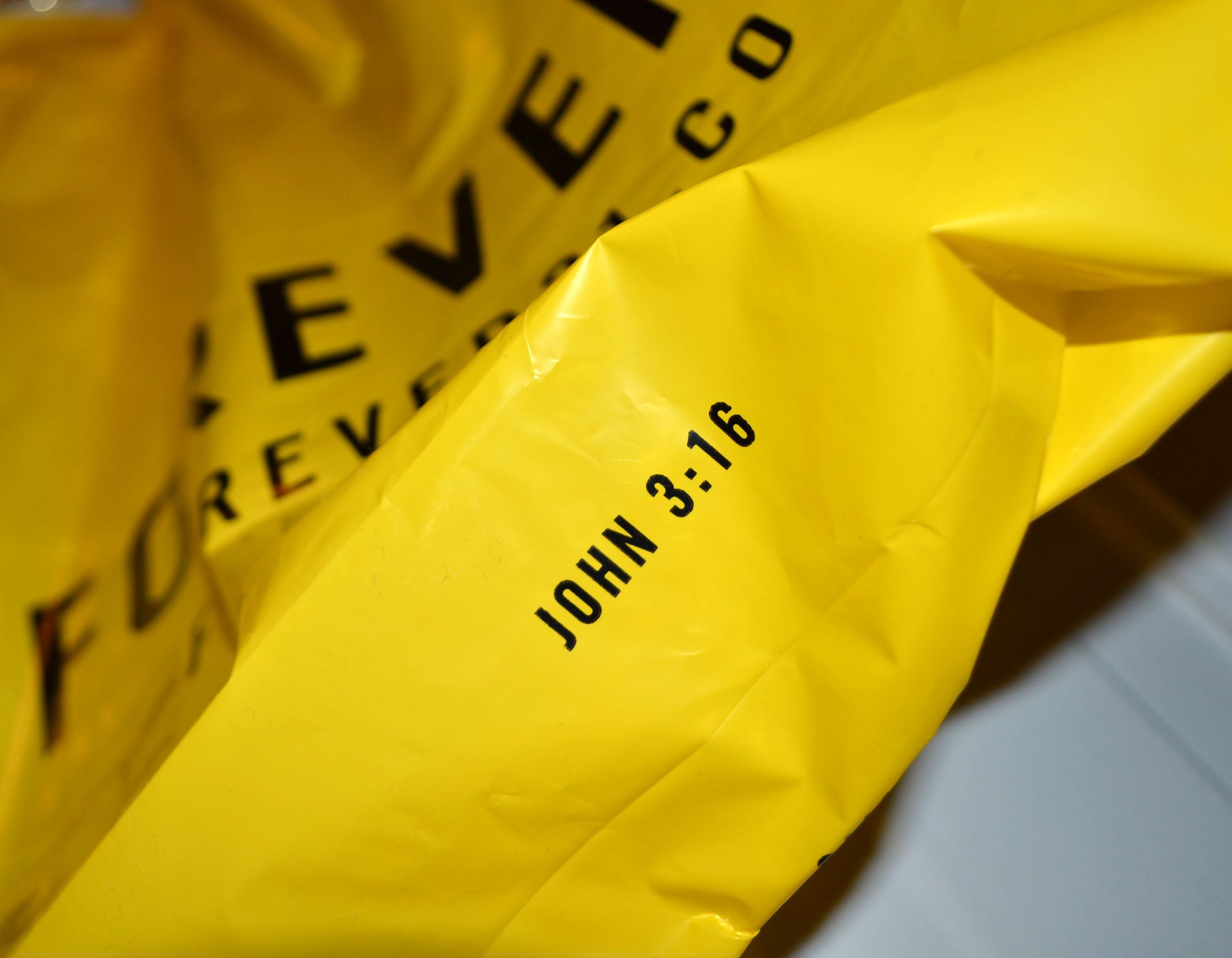 Forever 21 bags have the Bible verse John 3:16 written on the bottom.