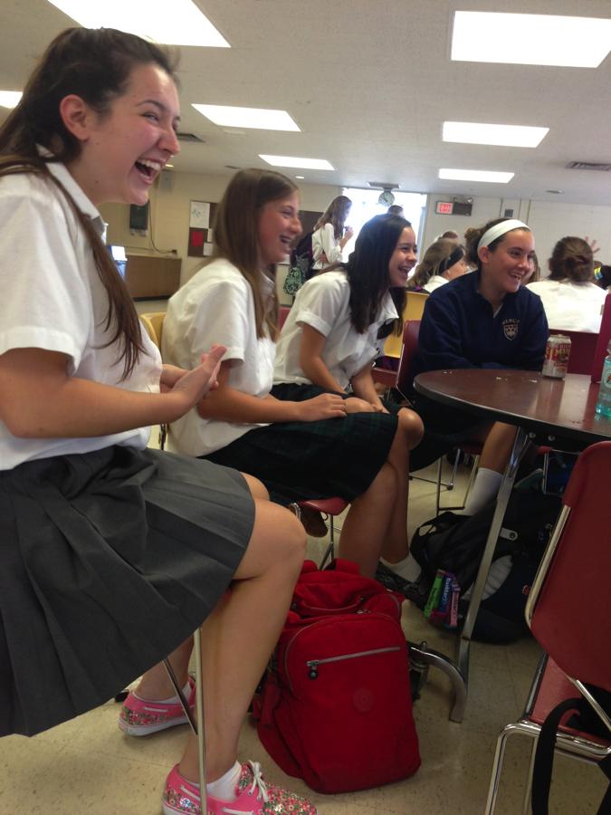 Senior Natalie Lewandowski shares a laugh with friends she made in her freshmen Gym Swim class.