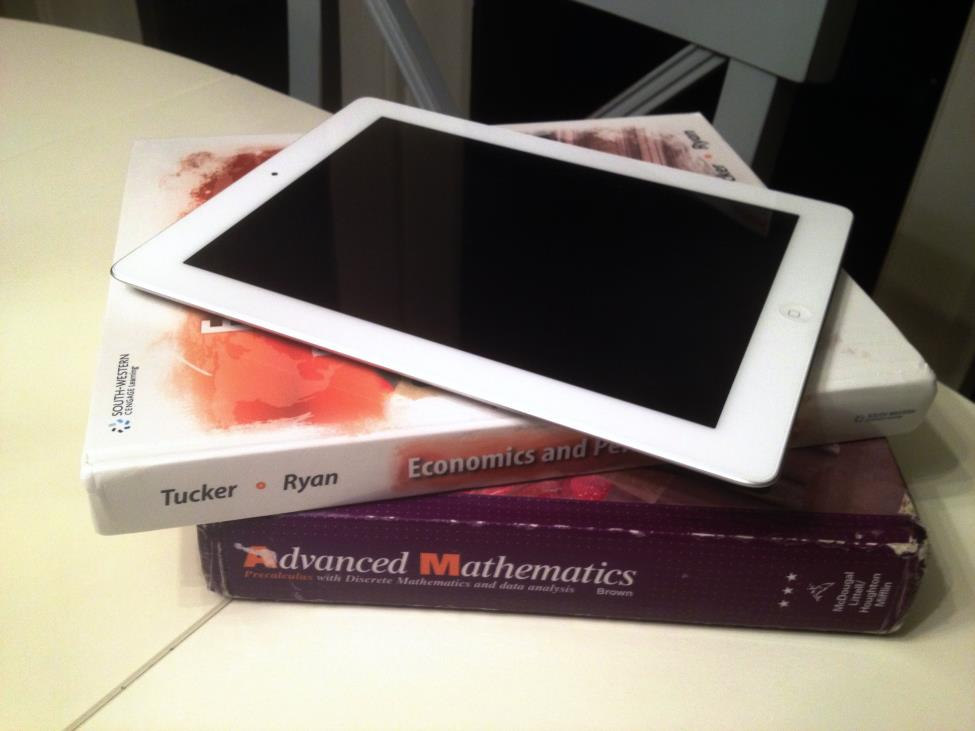 While e-books on iPads lessen the weight compared to clunky textbooks, they come with mixed opinions from many.