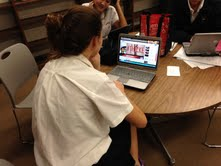 """Junior Julia Swoish watches the """"Blurred Lines"""" music video during an off hour."""