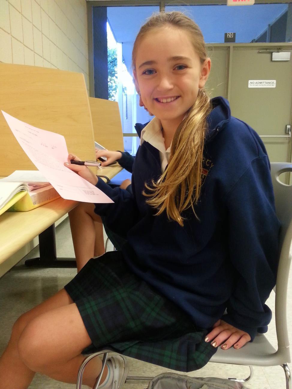 Freshman Ava Zaremski proudly holds her nomination form to be treasurer.