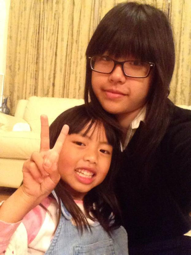 Siyi (top) hangs out and poses with her cousin (bottom).  Photo Credit: Siyi Xu