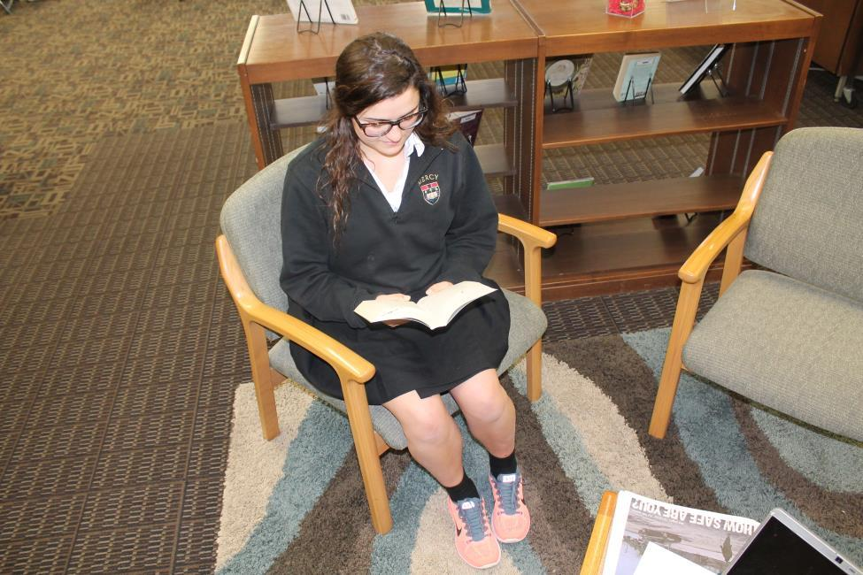 Junior Katina Nicholas reading Eleanor and Park, potential best love story winner, during an off hour.