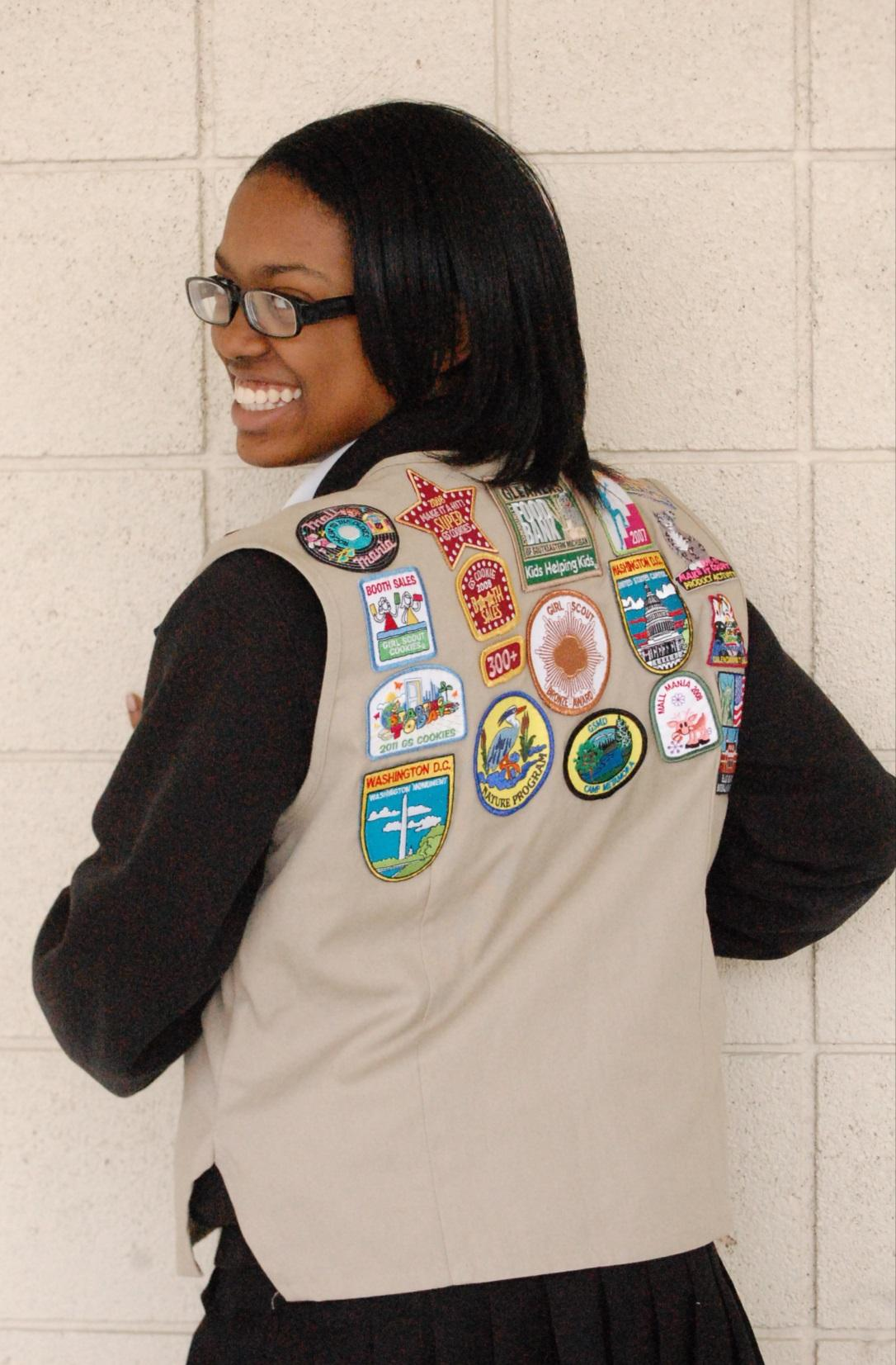 Williams, an Ambassador Girl Scout, has earned various patches recognizing achievements ranging from service at Gleaners Food Bank to selling over 300 boxes of Girl Scout cookies.